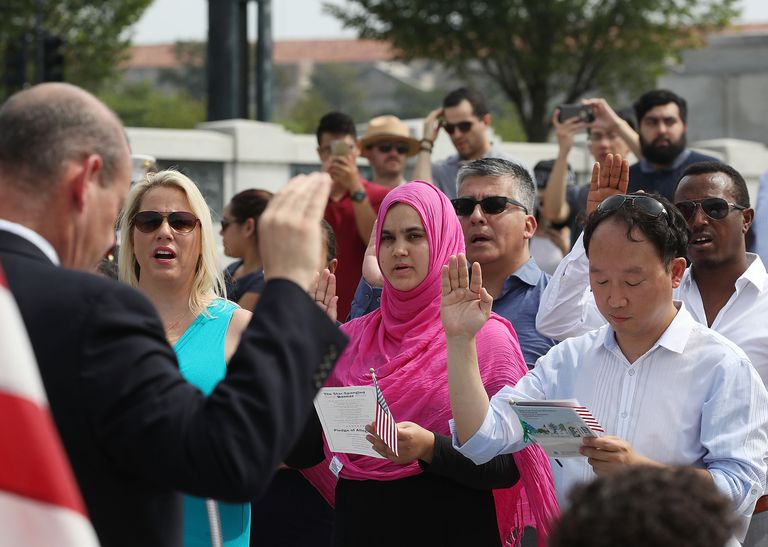 New US citizens being sworn in at the WWII Memorial in Washington DC
