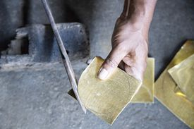 Blending copper and tin to produce a distortion free mirror in India