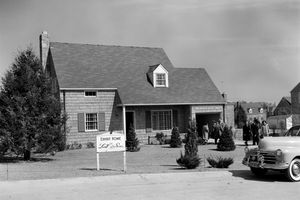 1950s MODEL HOME WITH SIGN...
