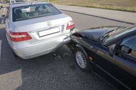 Two cars connected after a fende-bender.