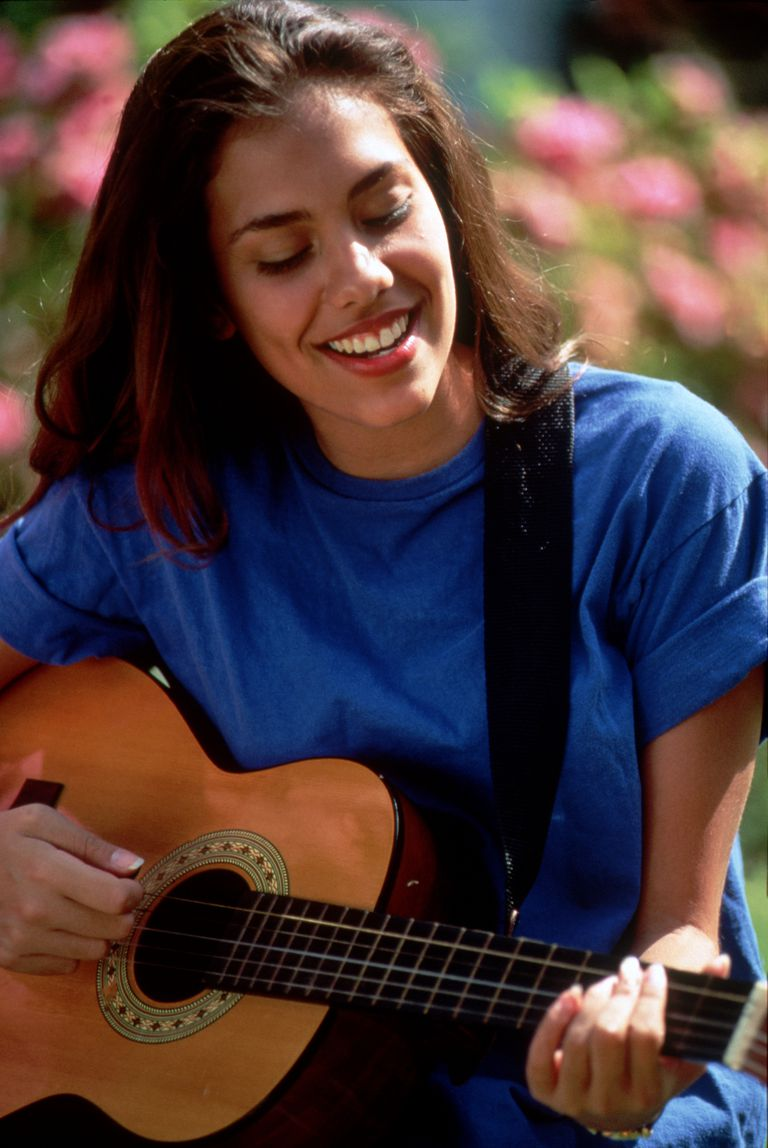 Teen Hispanic Girl Playing Guitar