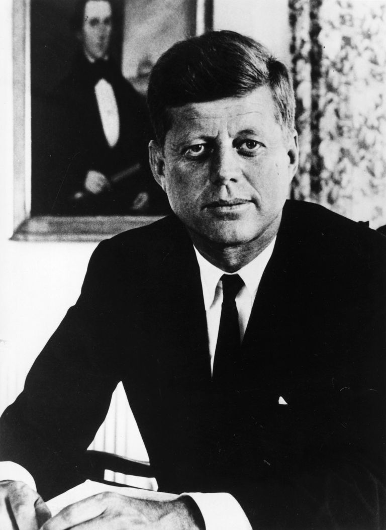 A picture of President John F. Kennedy sitting, circa 1961.