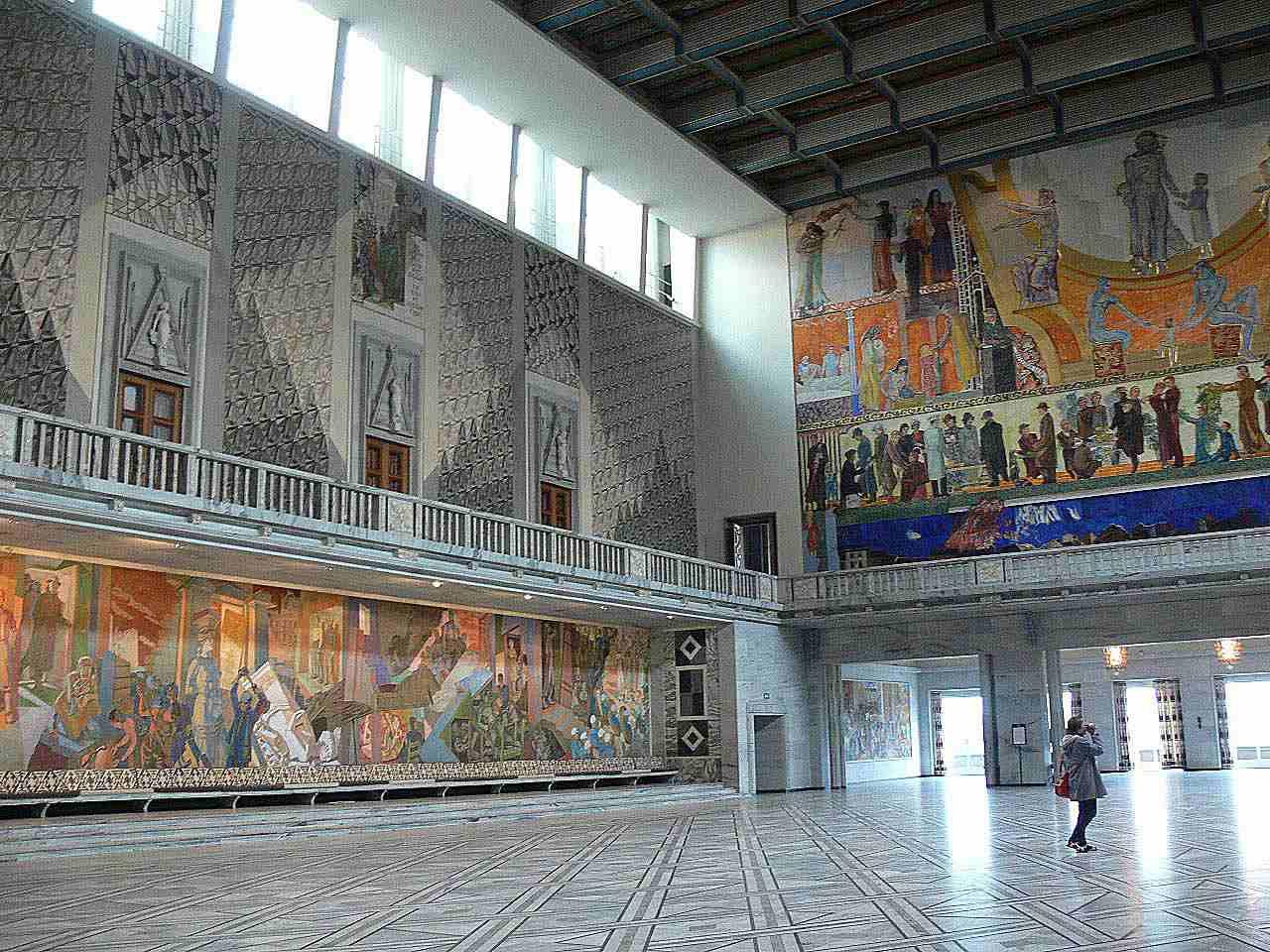 large hall, murals on walls, clerestory windows