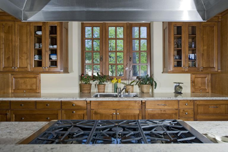 Feng shui kitchen has stovetop with direct visual access to doorway.