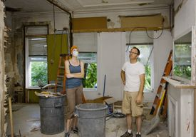 Man and woman standing in room under remodeling