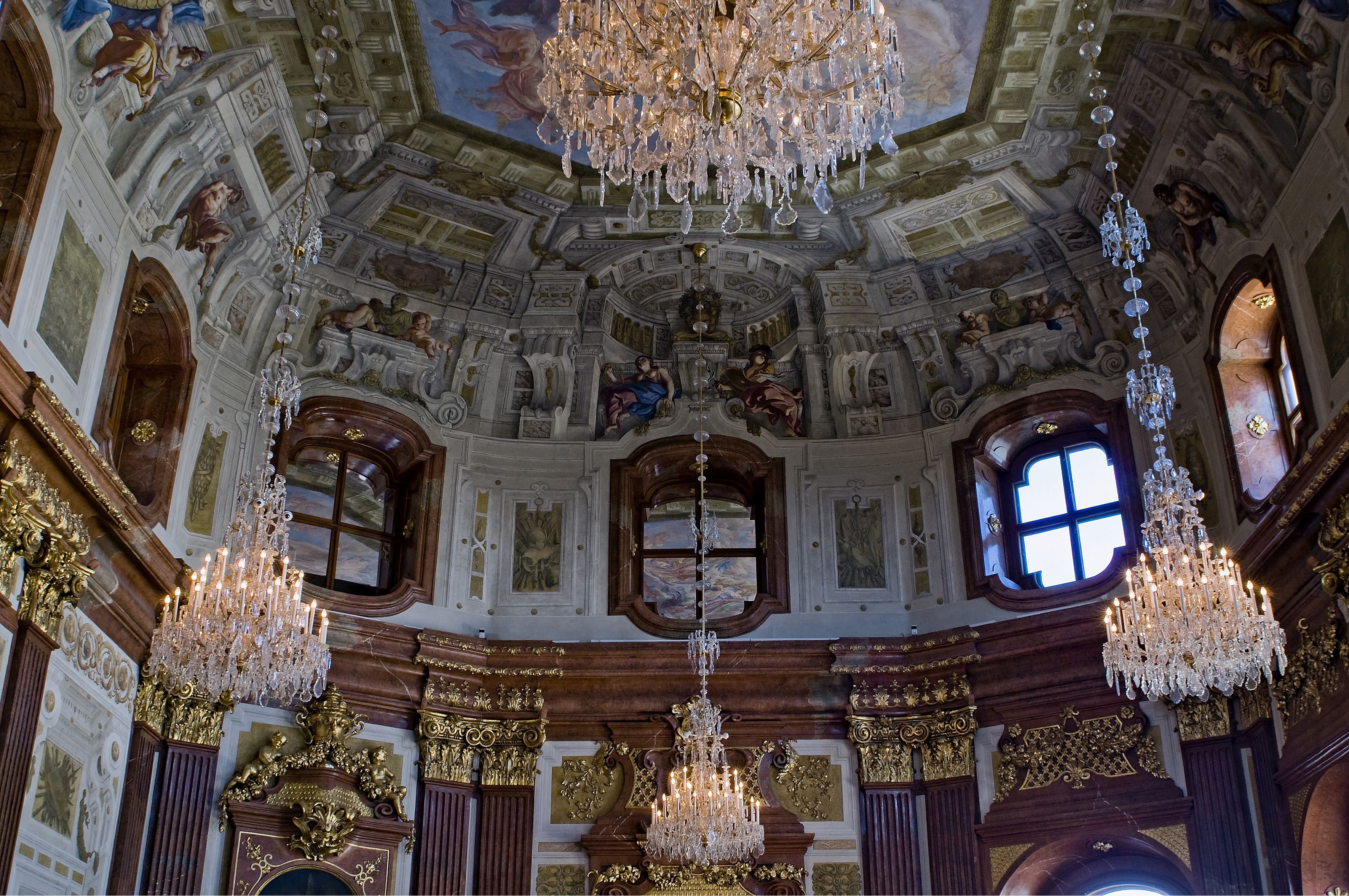 Ornate interior, including 4 chandeliers, of the Marble Hall at Upper Belvedere, Vienna, Austria
