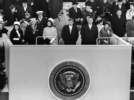 Black and white photo of the dais at JFK's inauguration
