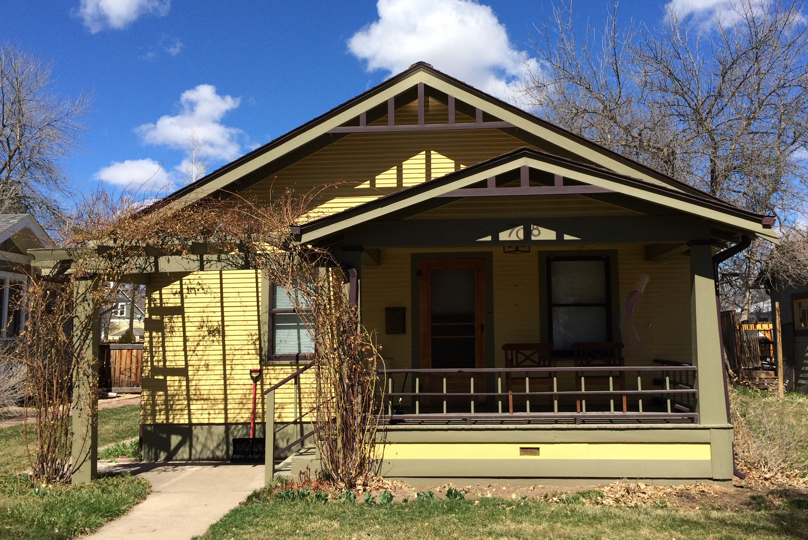 Yellow Bungalow With Green Trim Front Gable Have Porch Roof That Imitates