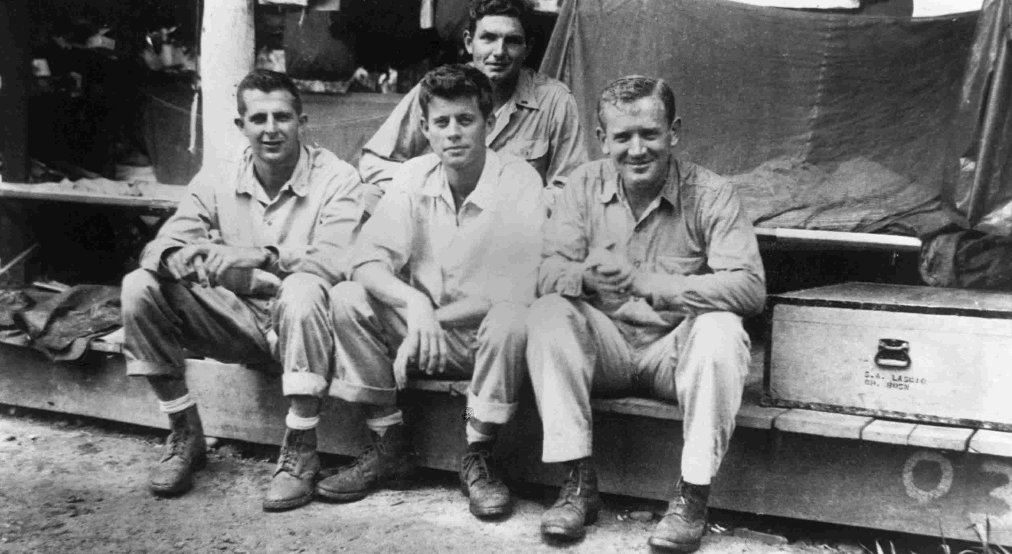 John F. Kennedy with fellow crew members