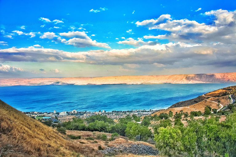 Scenic View Of Lake Tiberius By Mountain Against Cloudy Sky