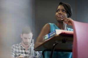 female student thinking at desk