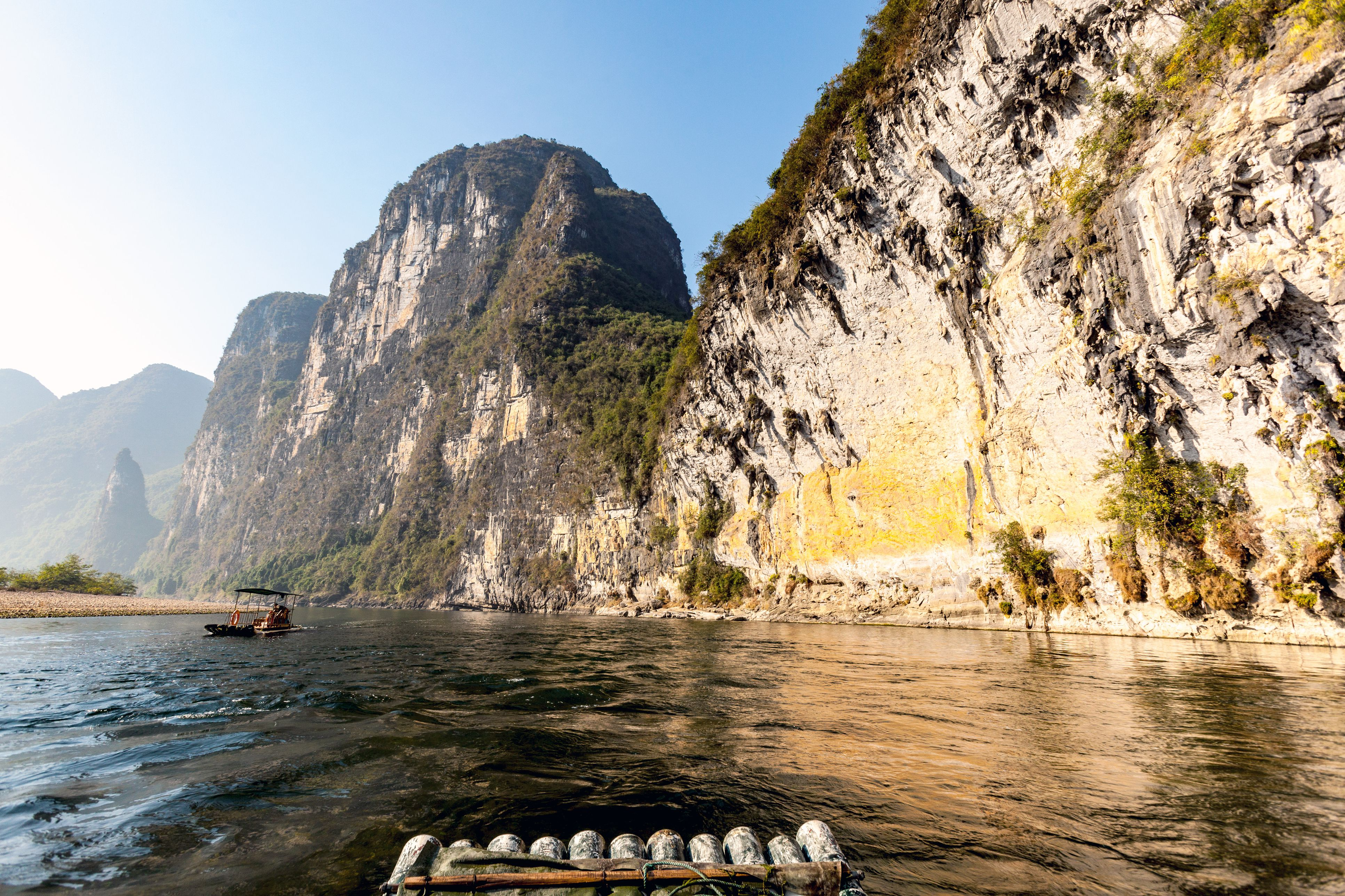 Morning on the Li River with rock formations in the back