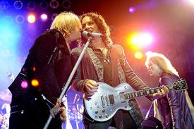 Singer Joe Elliott (L) and musician Vivian Campbell of Def Leppard perform at the after party for the premiere of Warner Bros. Pictures' 'Rock Of Ages' at Hollywood and Highland on June 8, 2012 in Los Angeles, California