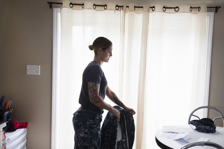 Military woman in her house