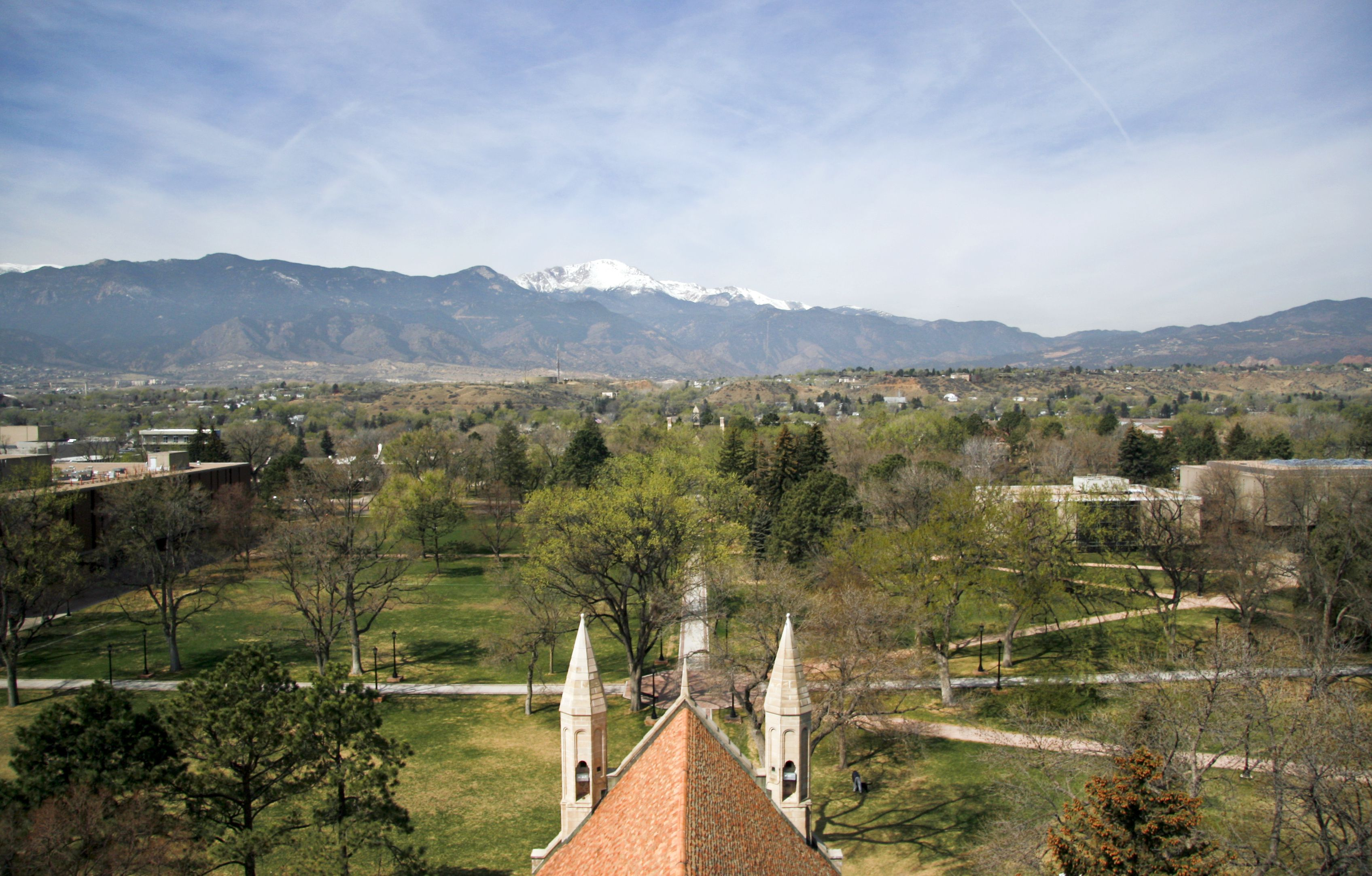 View of Colorado College from the top of Shove Memorial Chapel, showing the CC campus with Pikes Peak in the background