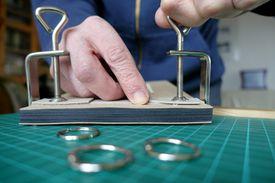 Craftsperson binding book in workshop