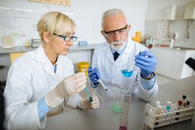 Team of scientists in research laboratory conducting science experiment