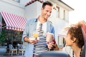 Man offers woman coffee