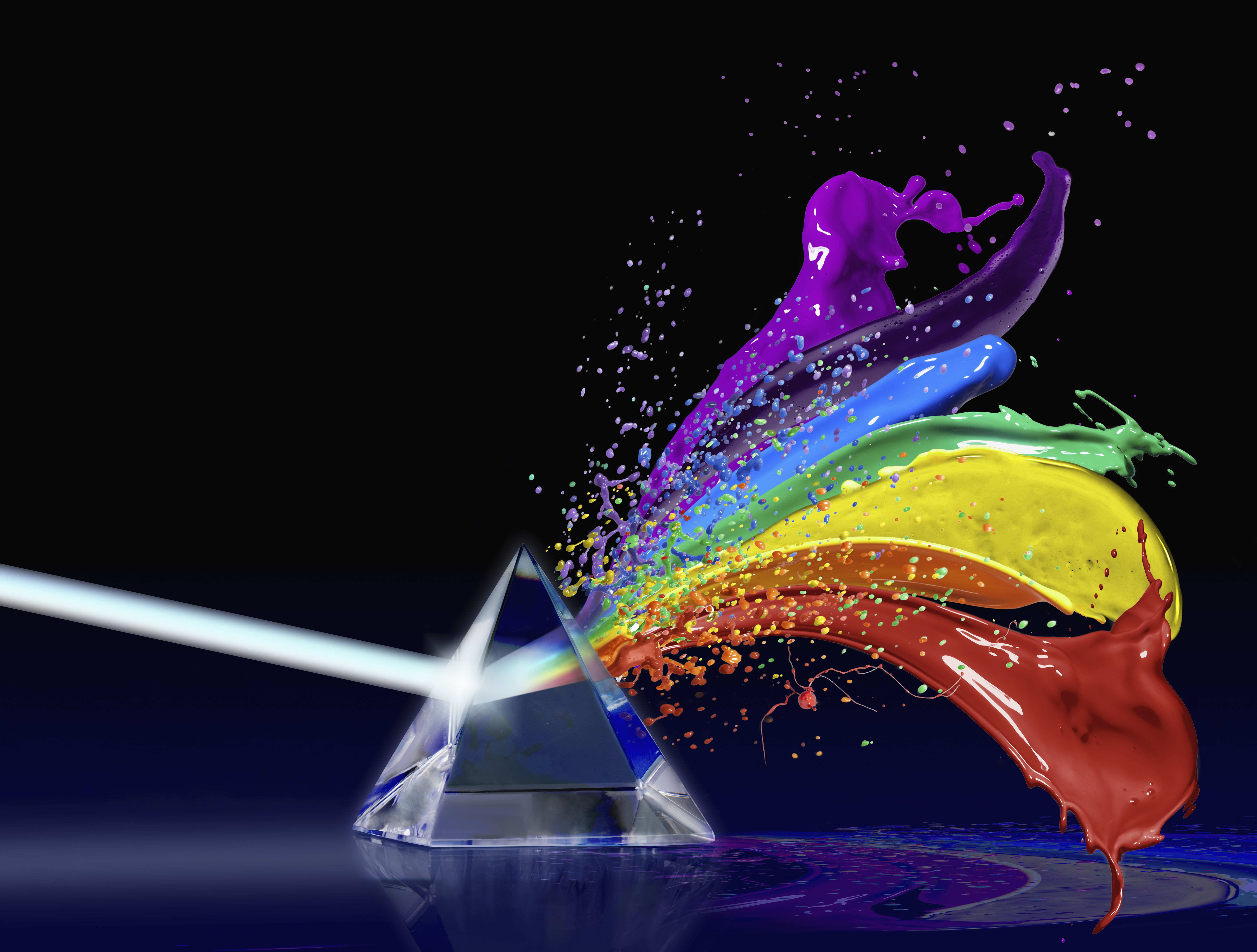 Light going through prism and coming out as splashes of paint in rainbow colors