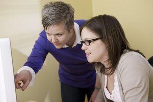 A women helps a coworker