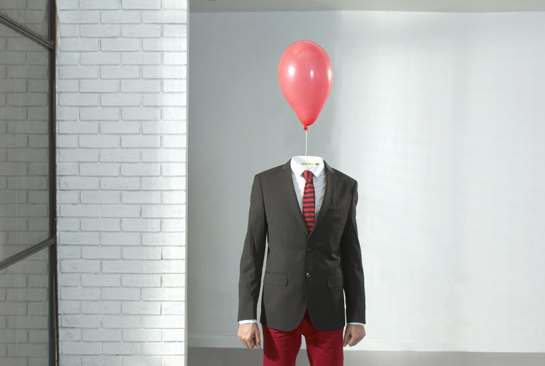 Man with balloon as a head