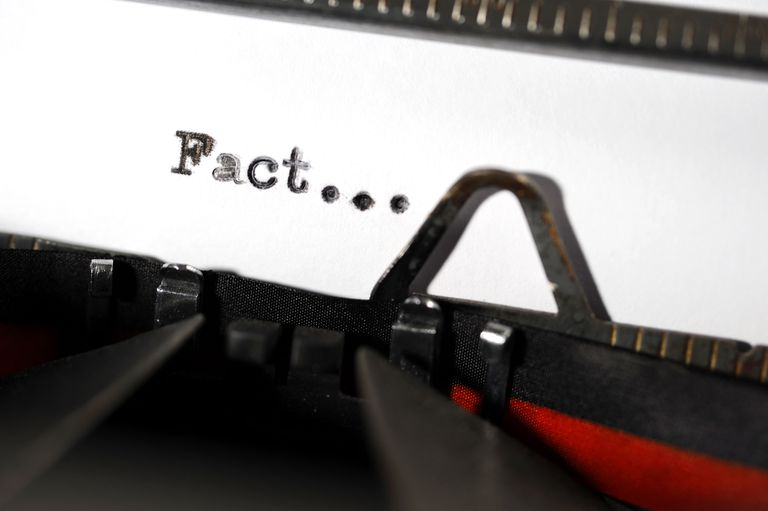 "typewriter typing the word ""fact"""