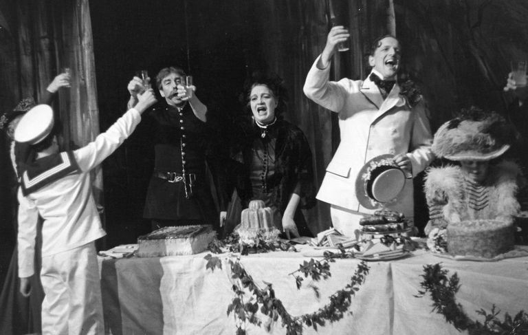 In this scene from the first act of Benjamin Britten's opera, Albert Herring, Albert Herring (performed by Peter Pears) is toasting his election as May King in his town's May Day Festival. Little does he know what the night has in store for him. David Spenser, Norman Lumsden and Joan Cross are also in the scene.