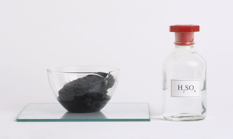 Sugar changed to black carbon in glass bowl after mixing with sulfuric acid.
