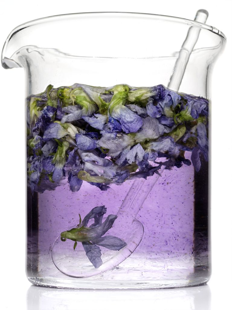 Beaker filled with alcohol and lavendar (lavendar tincture)