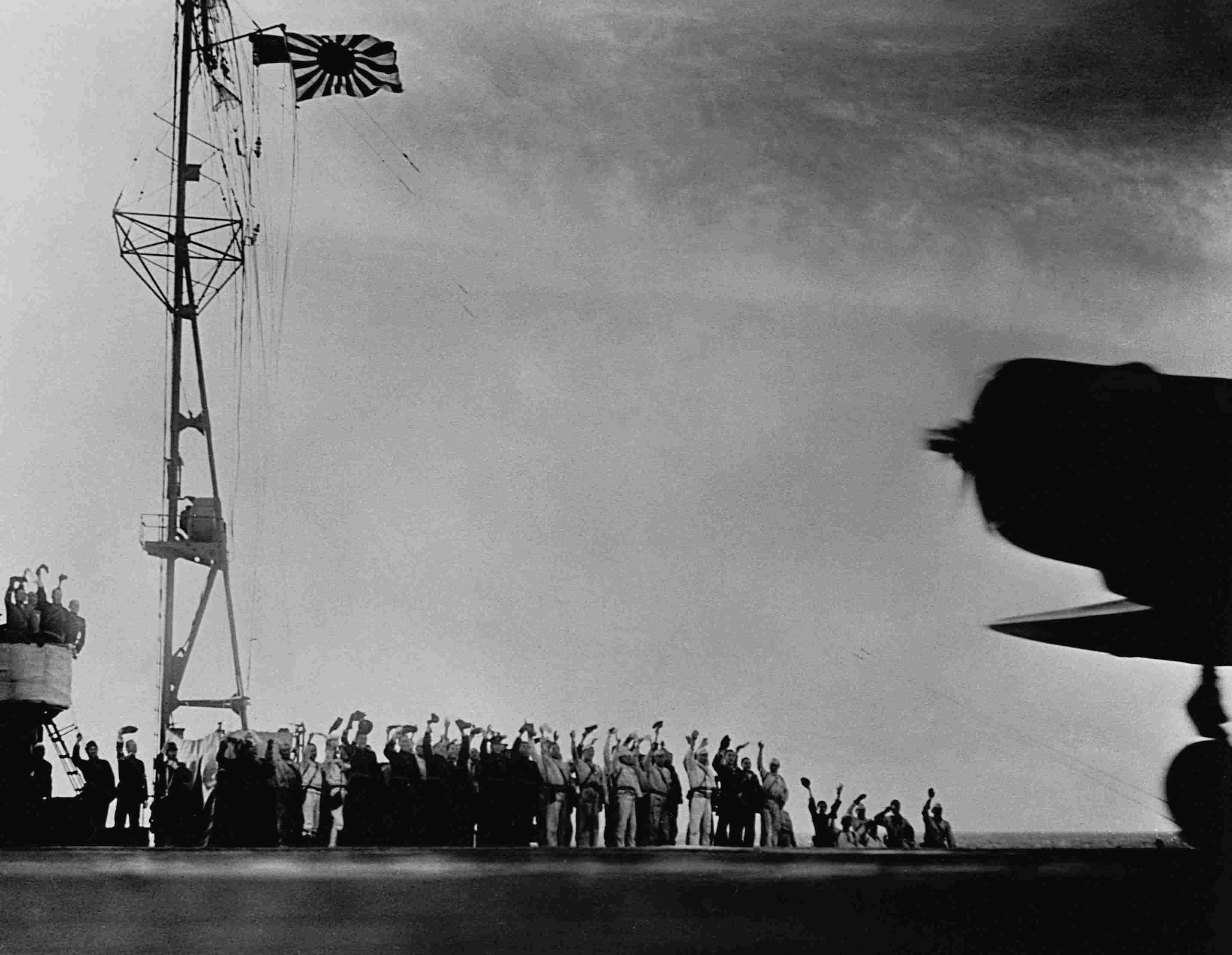 Rising sun flag over japanese sailors