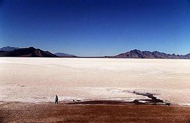 The Bonneville Salt Flats is the remnant of Lake Bonneville which covered one third of the State of Utah over 10,000 years ago. It is one of the most consistently flat areas on earth, which makes it the ideal home for landspeed record attempts.