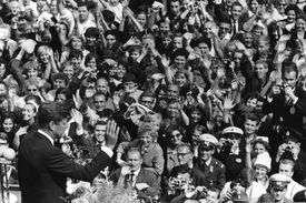 JFK speaking to crowd in Berlin, black and white photograph.