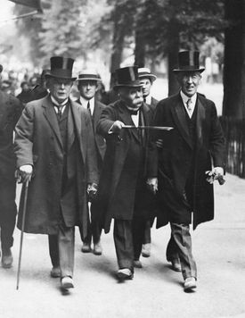 A picture of Lloyd George, Clemenceau, and Wilson heading to the Versailles Peace Conference.