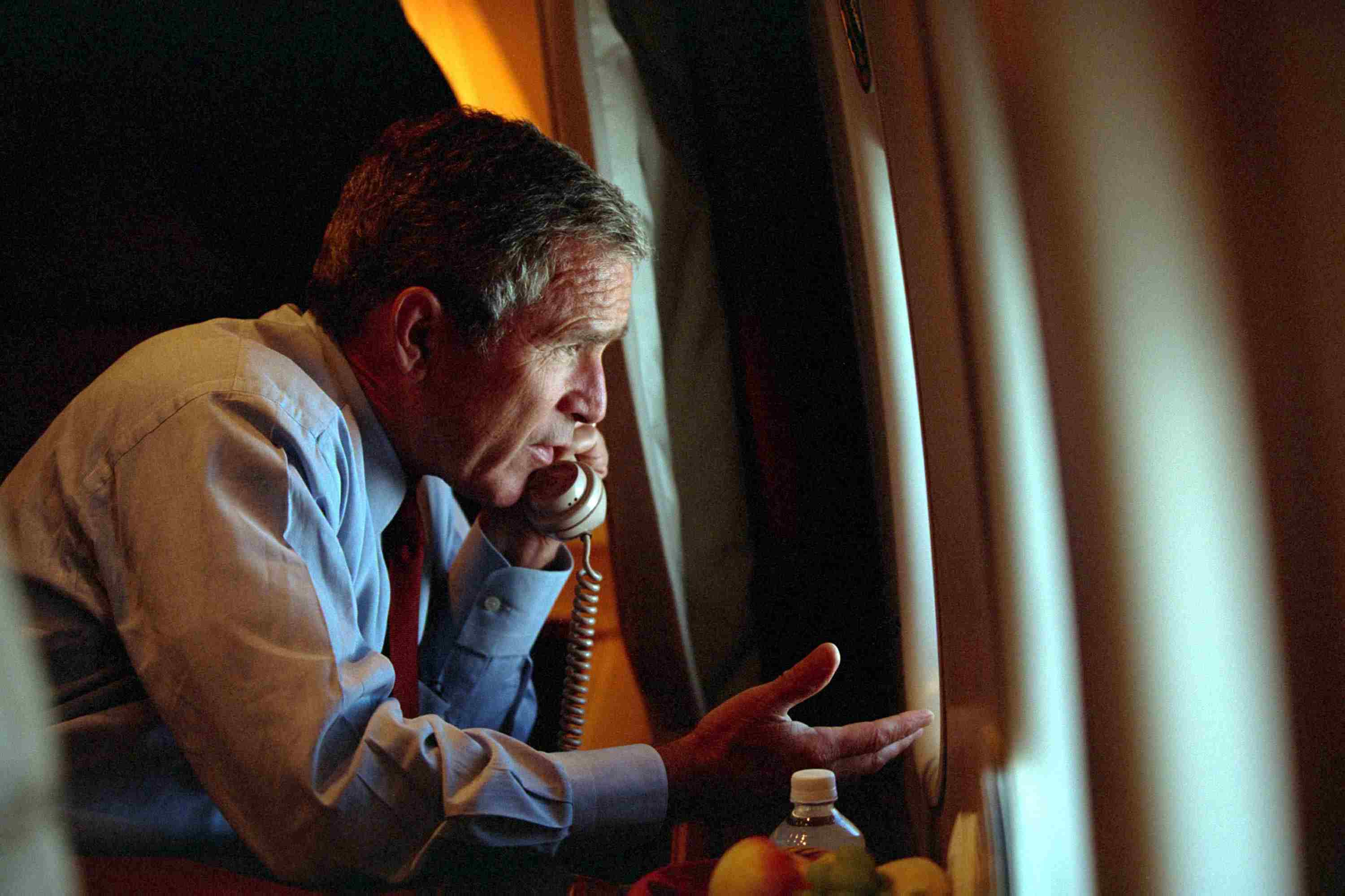 President Bush talking on the phone in Air Force One