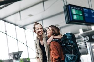 Young Backpacker Couple At The Airport
