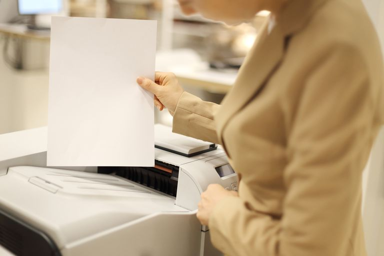 Businesswoman using printer