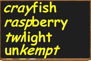 The words crayfish, raspberry, twilight, unkempt on chalkboard