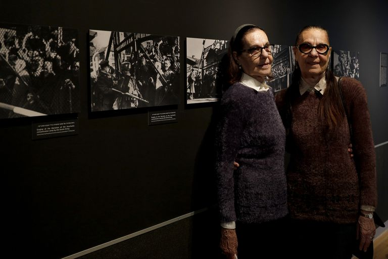 Identical twins at a Holocaust exhibit.