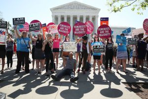 Pro-choice and anti-abortion protesters converge outside of a government building