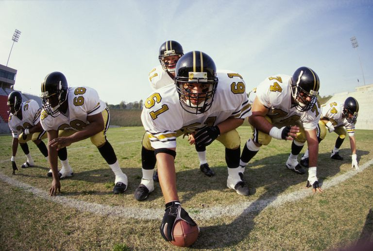 offensive line of football team