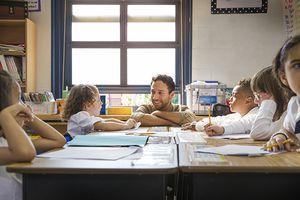 Teacher talking to little girl
