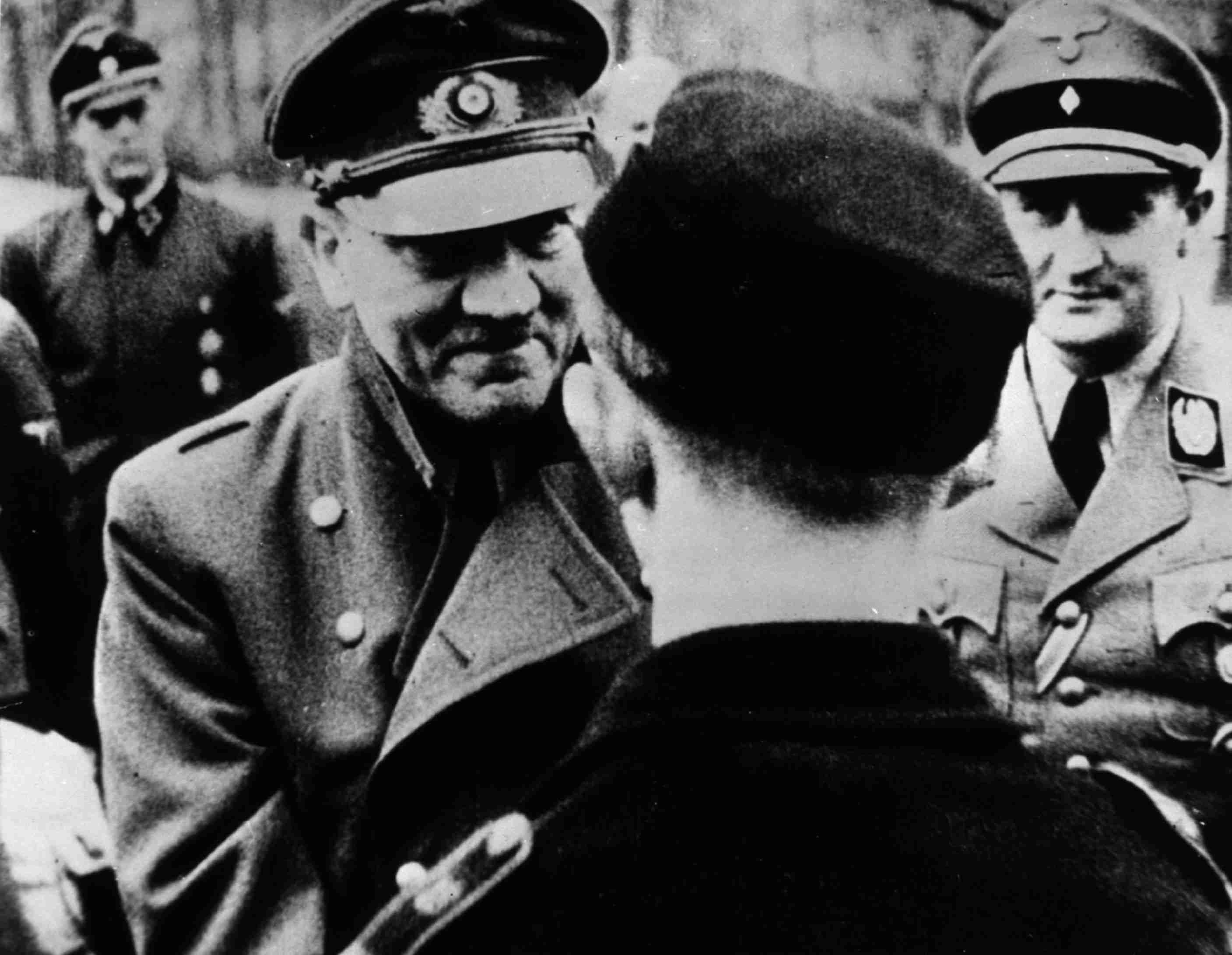 In his last official photo, Adolf Hitler leaves the safety of his bunker to award decorations to members of Hitler Youth.