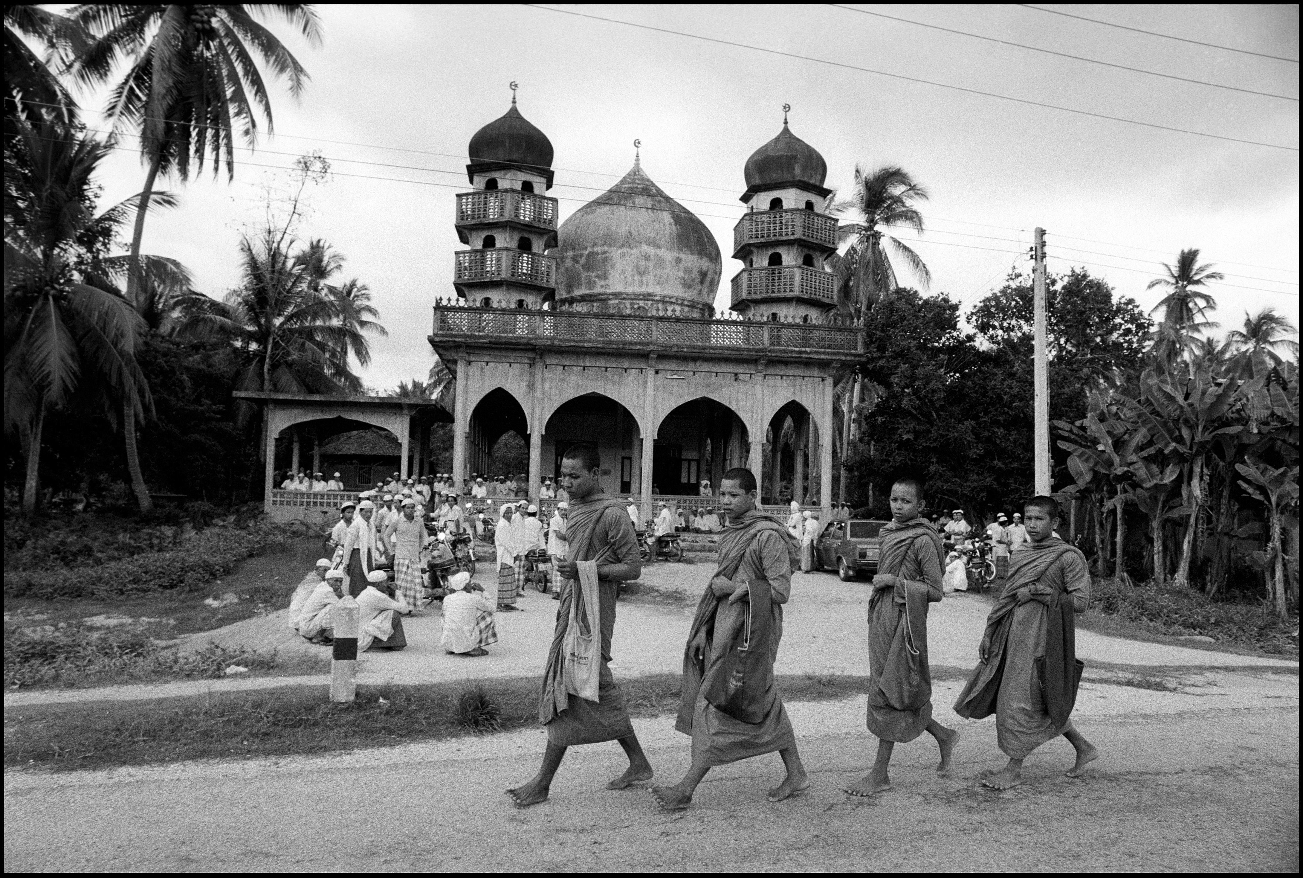 Buddhist monks and a mosque in Pattani, 20th century