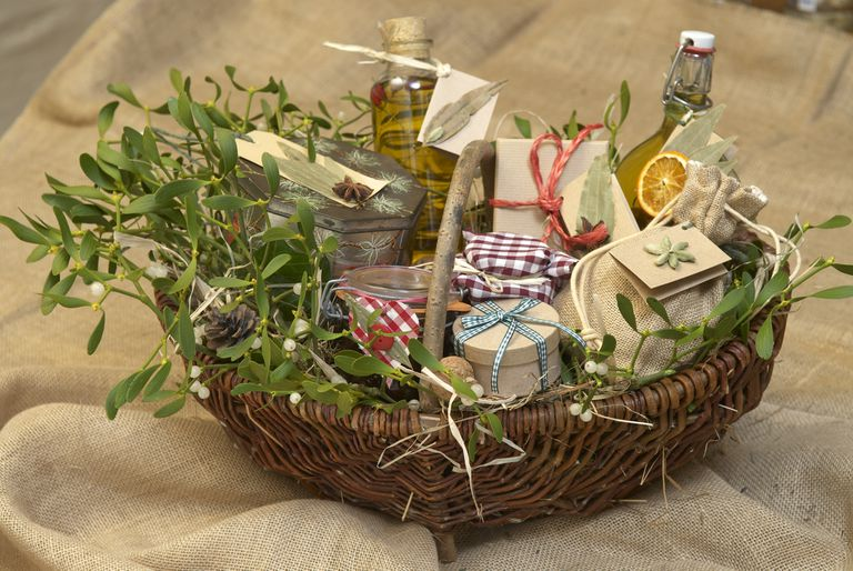 hamper containing gift items decorated with mistletoe