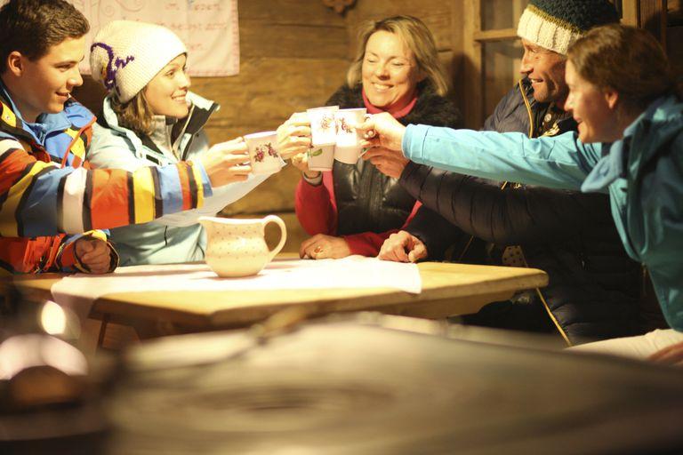 Friends drinking in ski gear