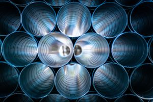 Large Aluminum Pipes Stacked At Factory