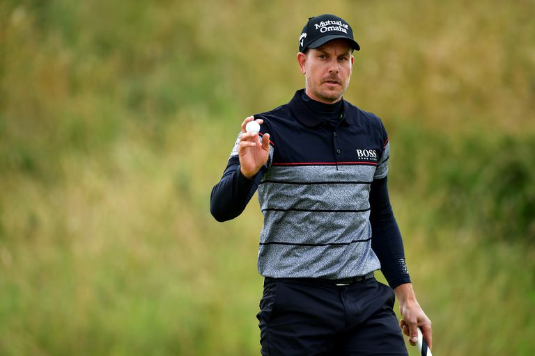 Henrik Stenson of Sweden celebrates a birdie putt on the 10th during the final round on day four of the 145th Open Championship at Royal Troon