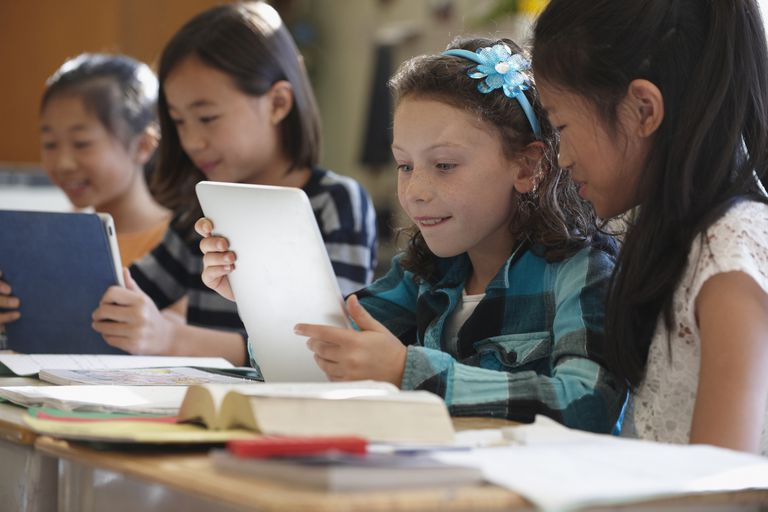 Students using digital tablets in class