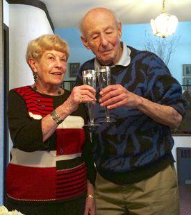 Older couple sharing glasses of wine