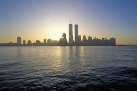 Looking over water at a Skyline of New York City and two tall rectangular towers